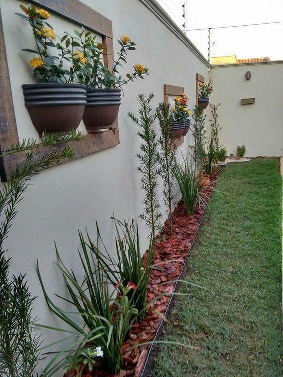 60 fotos de muros decorados com plantas for Plantas pequenas para jardin