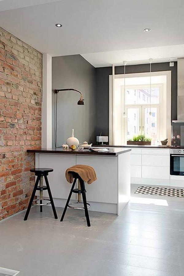 cozinha integrada com tijolo