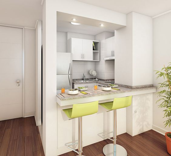 cozinha com cadeiras amarelas