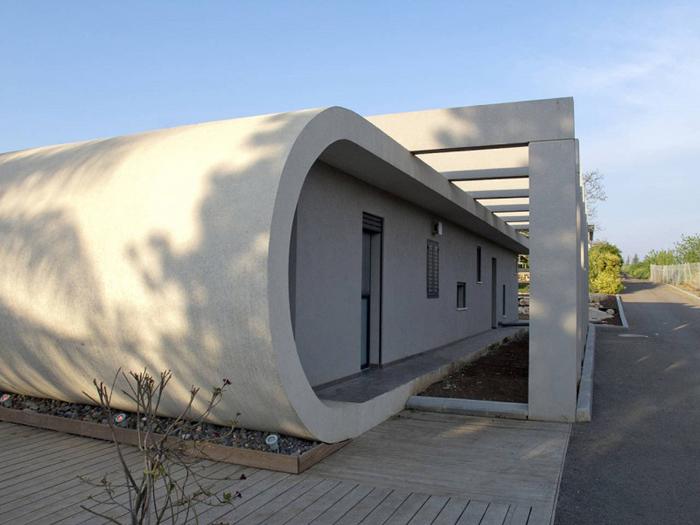 casa futurista com concreto aparente