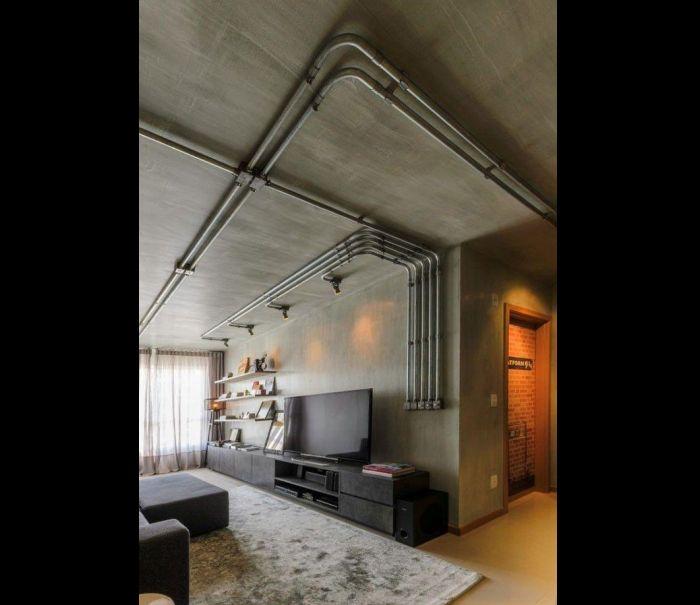 canos na parede com concreto aparente