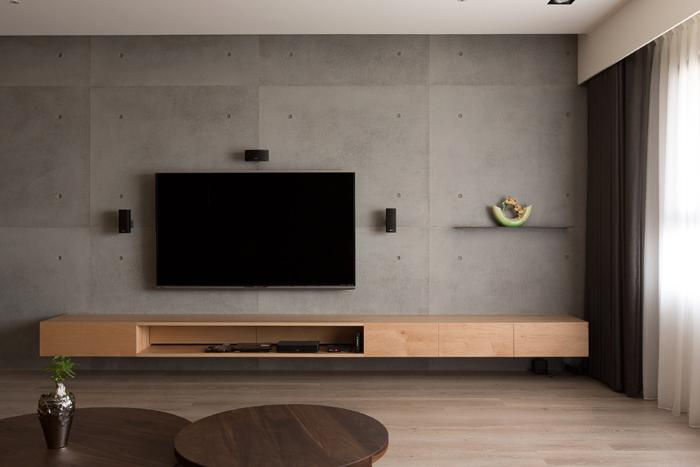 sala clean parede com concreto aparente