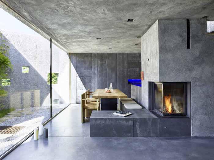 sala de jantar parede com concreto aparente