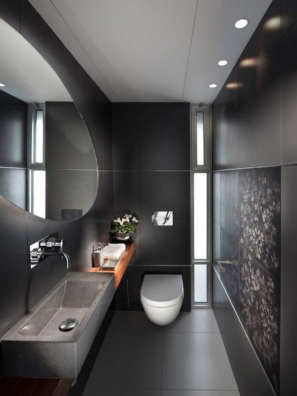 Banheiro pequeno com decoração escura