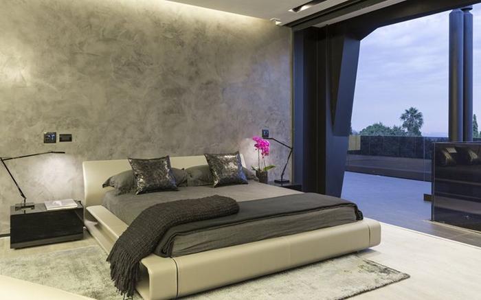 quarto futurista com parede com concreto aparente