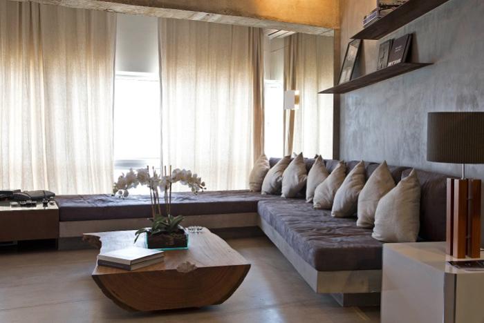 sala rustica com parede com concreto aparente
