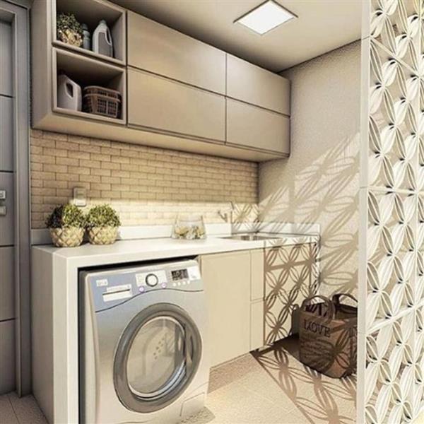 lavanderia com maquina de lavar