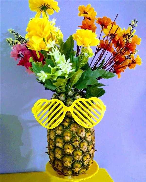 abacaxi decorado com flores