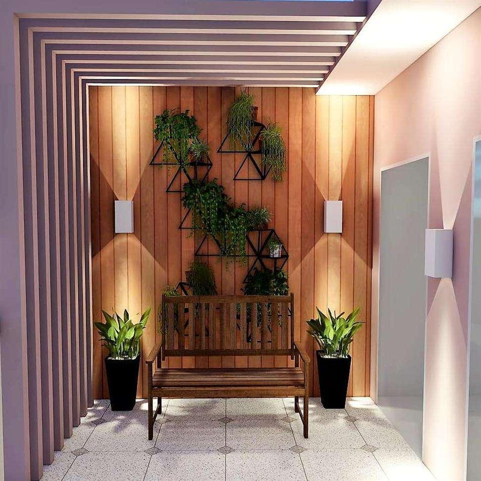 decoração com arranjos de plantas na parede